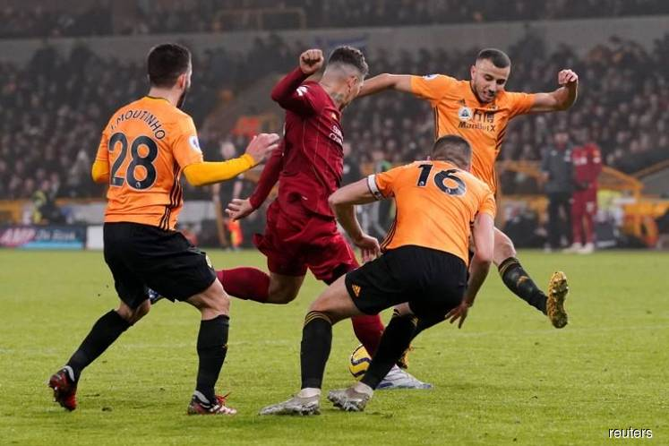 Liverpool charge towards title with win at Wolves