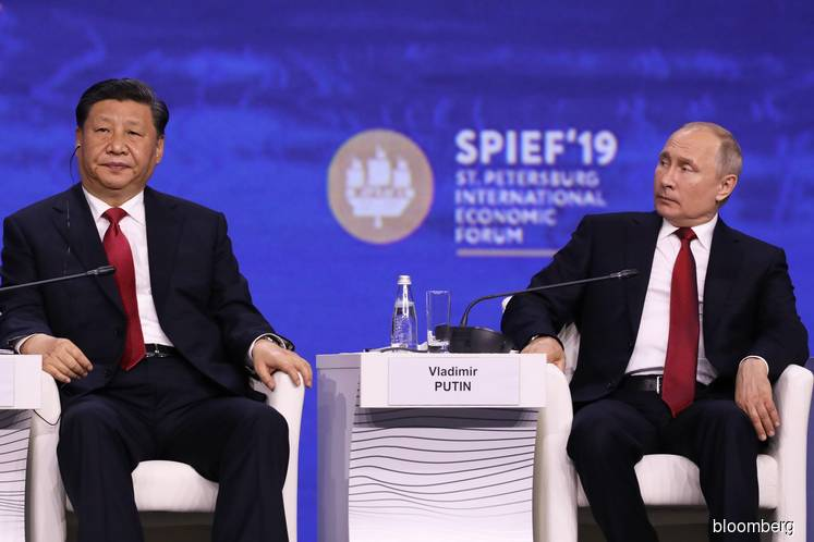 Xi, Putin condemn U.S. dominance as tensions with Trump grow