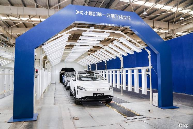 Tesla's Chinese challenger Xiaopeng rolls out 10,000th SUV as electric vehicles chip away at China's car market