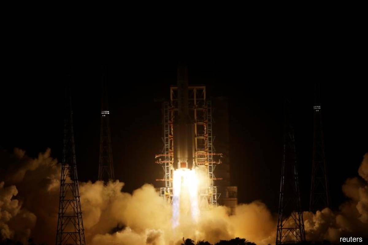China's launch of rocket carrying probe to moon declared a success