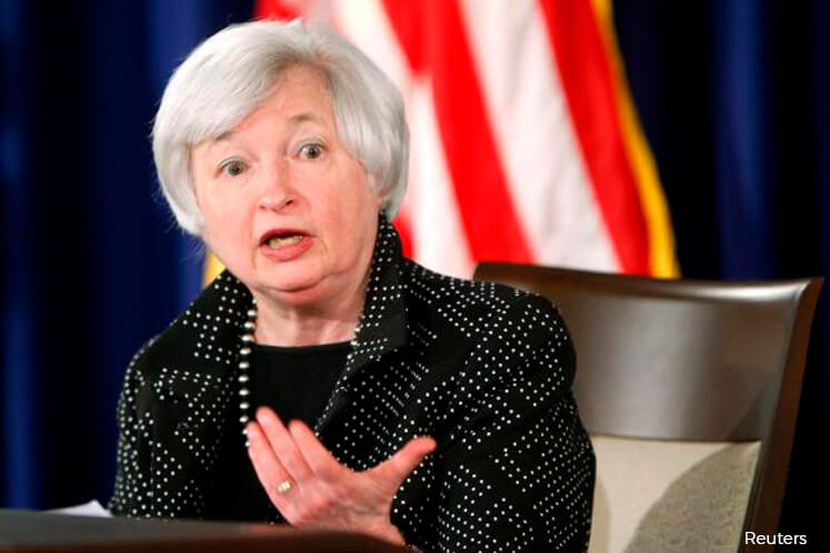 Fed raises rates, unveils balance sheet cuts in sign of confidence