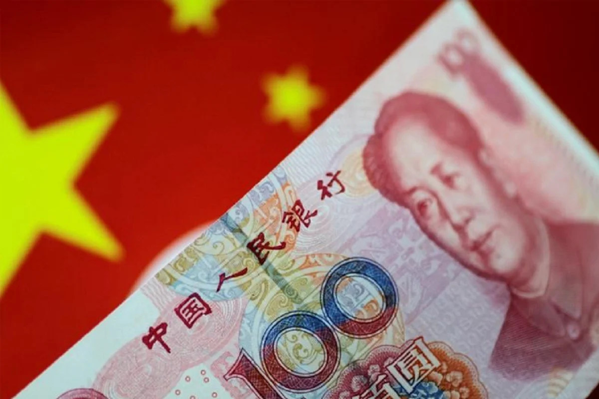 The yuan was last steady in onshore trade at 6.6982 per US dollar after hitting a fresh 18-month peak of 6.6852 in morning trade. (Photo by Reuters)