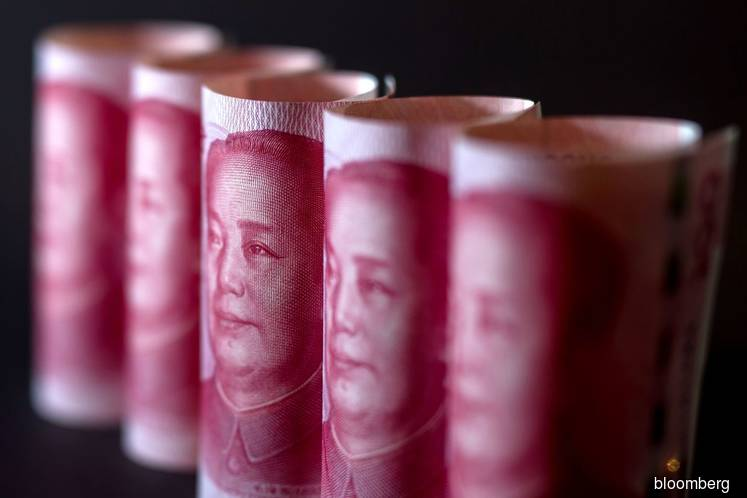 Offshore yuan slumps to record low, Hong Kong stocks plunge