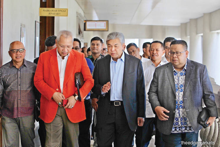 Azlan testified that Ahmad Zahid (centre) had never once asked him for the money. <em>Photo by Shahrin Yahya</em>