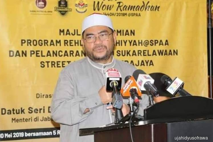 Najib's seat at the King's installation ceremony decided earlier — Mujahid