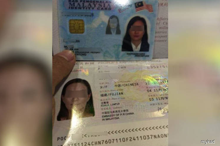 Penang NRD assistant director among six charged with faking, selling birth certs, MyKad