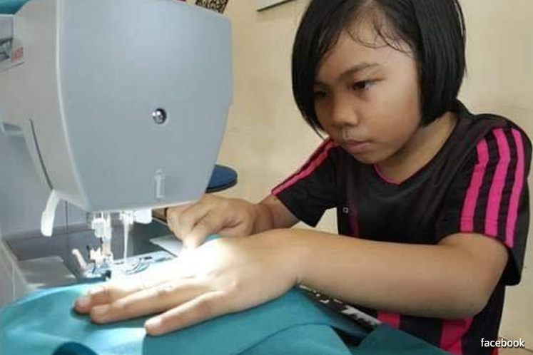 For Malaysian schoolgirl, homework is sewing PPE gowns to help beat coronavirus