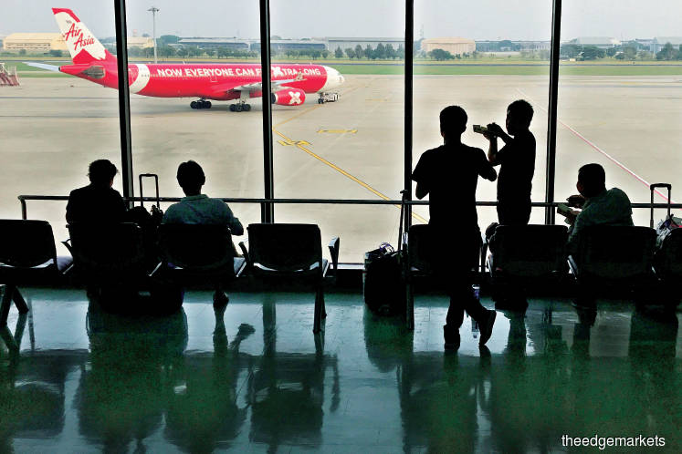 AirAsia, AirAsia X suspend flights, ground most planes; pay cut for top executives