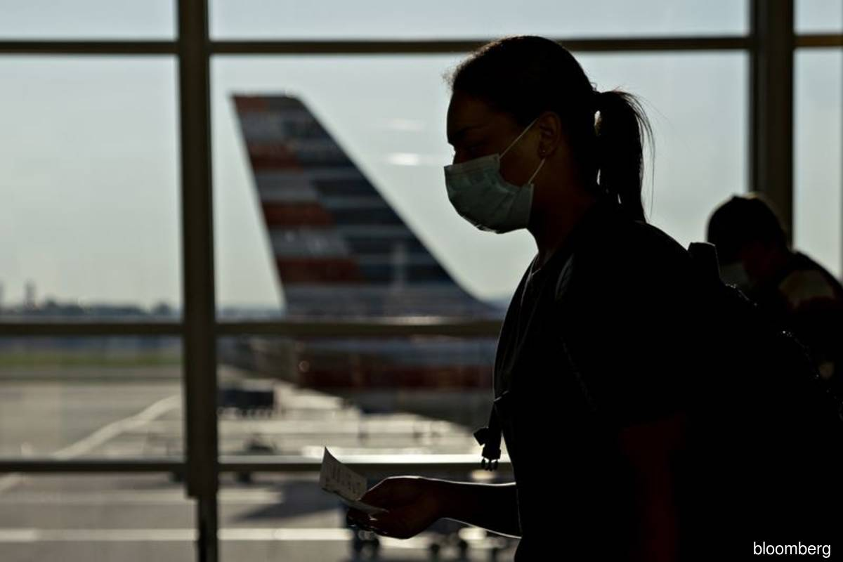 American Air offers new incentives in bid to limit pilot layoffs