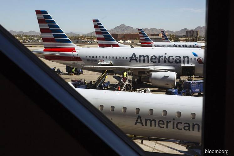 U.S. airline rout worsens with American hitting record low