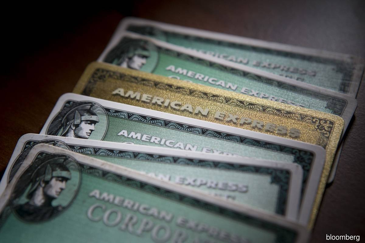 AmEx profit falls 15% as pandemic pummels spending, shares drop