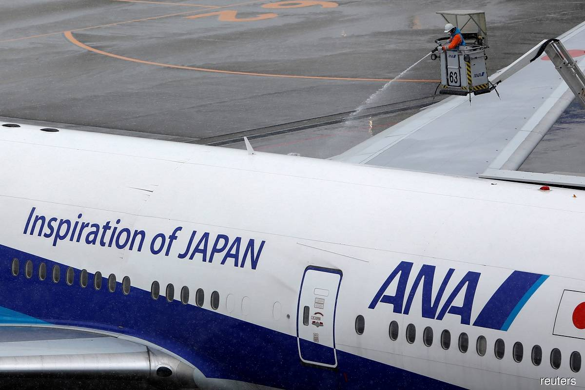 Japanese airline ANA to report narrower-than-expected financial year loss on cost cuts, tax assets