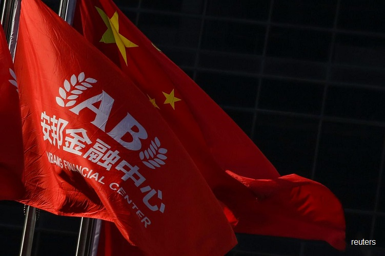 China's troubled Anbang to slash registered capital by a third