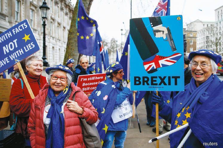 Anti-Brexit protesters in front of Downing Street in London … all eyes will be on Brexit with the UK on track to officially leave the EU on Jan 31. Photo by Reuters