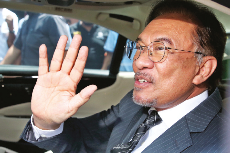 Anwar seeks to strike out suit questioning royal pardon, says the matter is non-justiciable