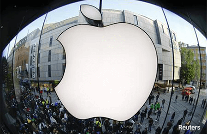 Apple shares hit record close on optimism for next iPhone