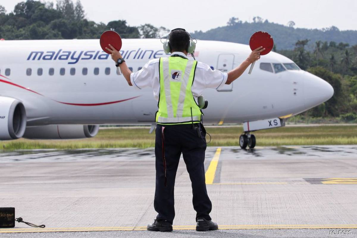 Asia's airlines ramp up flights, offers as tough Covid-19 travel curbs ease
