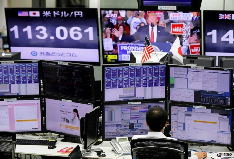 Asian shares up on accommodative Fed; growth concerns linger