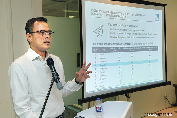Azmir presenting Mavcom's recommendations for the civil aviation sector in Kuala Lumpur yesterday. He says the downgrade of the CAAM by the FAA to Category 2 from Category 1 last year would have a minimal direct impact on passenger growth and Malaysian carriers' profitability in the foreseeable future. (Photo by Chu Juck Seng)