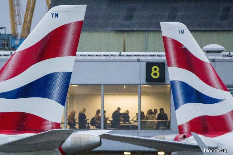 British Air Quits China on Virus as U.S. Carriers Cut Back