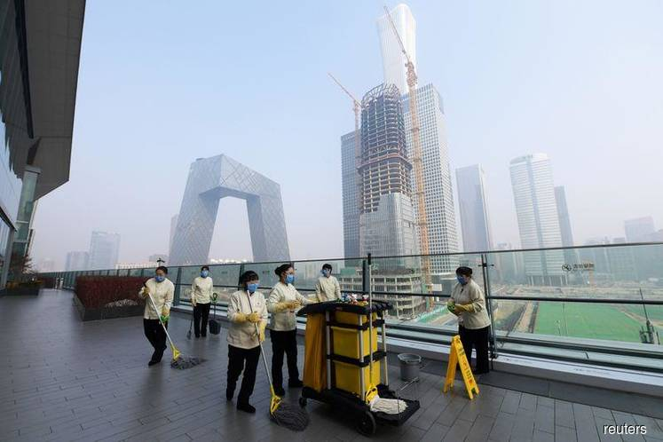 The Chinese capital Beijing on Friday imposed a 14-day self-quarantine on people returning to the city from holidays to prevent the spread of the new coronavirus, and threatened to punish those who failed to comply.  It was not immediately clear how the restriction, relayed by the official Beijing Daily newspaper, would be enforced, or whether it would apply to non-residents of Beijing or foreigners arriving from abroad.