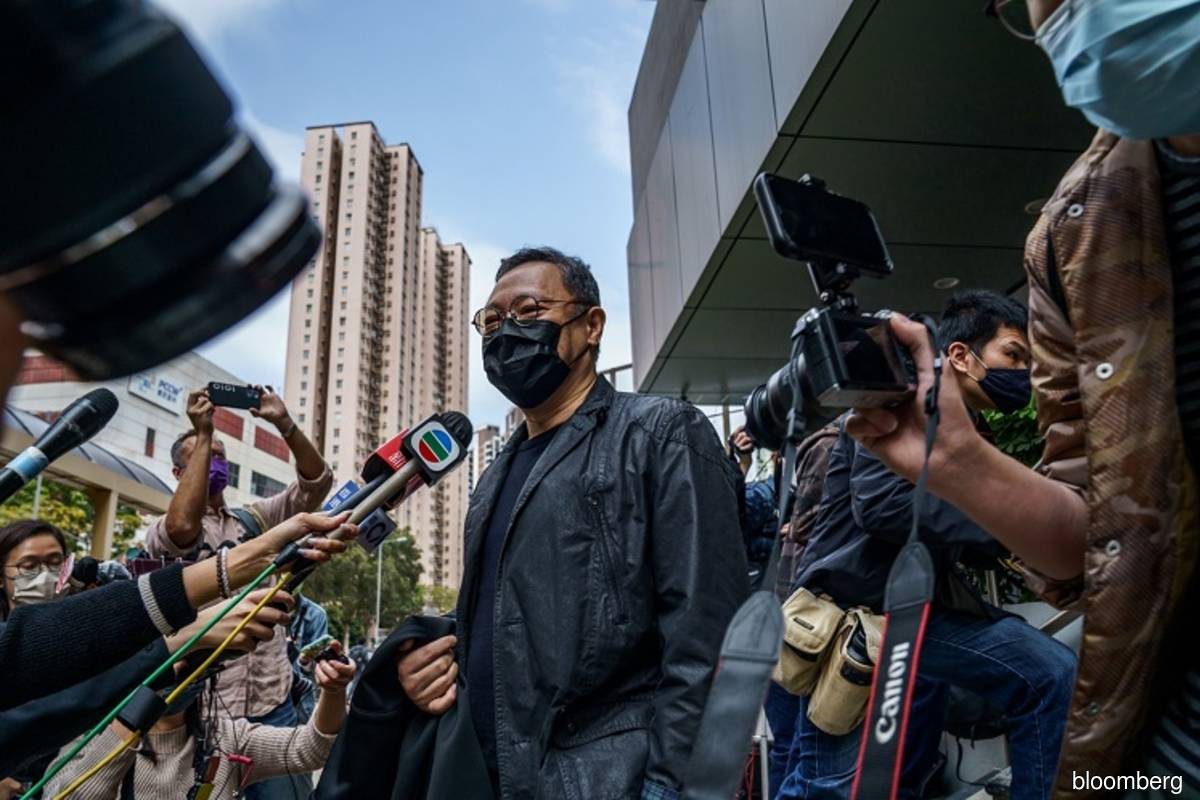 Pro-democracy activist Benny Tai speaking to the press after arriving at Ma On Shan police station in Hong Kong, China on Feb 28.