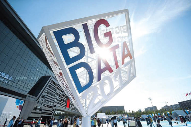 Visitors outside the venue of the China International Big Data Industry Expo in Guiyang, Guizhou province
