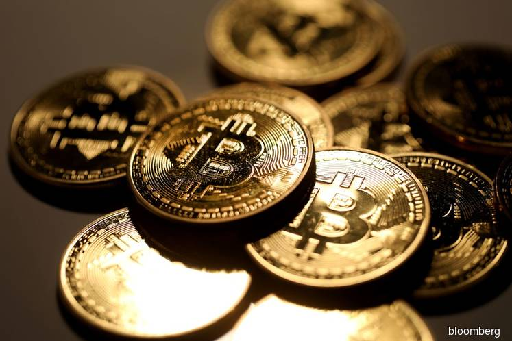 Bitcoin jumps back above US$6,000 to give respite to investors