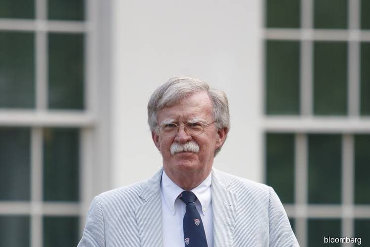 Bolton says in book Trump sought Xi's help in re-election bid