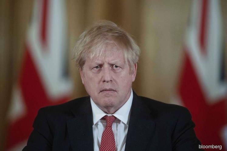 U.K.'s Johnson in hospital with persistent virus symptoms