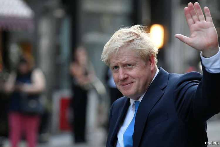 The British government said on Wednesday that it was time to move on after Prime Minister Boris Johnson's senior adviser provoked outrage and widespread scorn by making a 400 km (250 mile) road trip during the coronavirus lockdown. (Photo by Reuters)