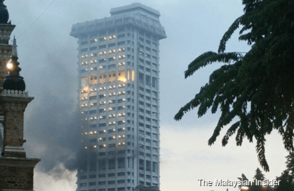 Old Bukit Aman tower block on fire