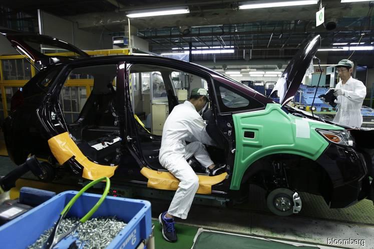 Honda and Hitachi to merge four car parts makers, Yomiuri says