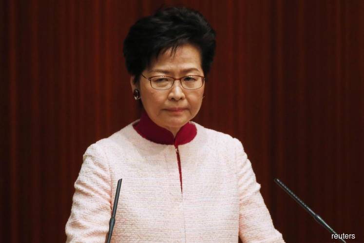 Hong Kong leader says rule of law being damaged, city's recovery will take long time