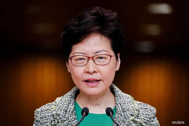 Hong Kong leader hopes for peaceful resolution of university standoff