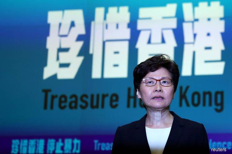 Hong Kong leader invokes emergency powers to try to quell escalating violence