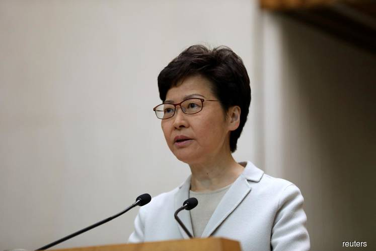 Humiliated at polls, Hong Kong's Lam acknowledges discontent with govt