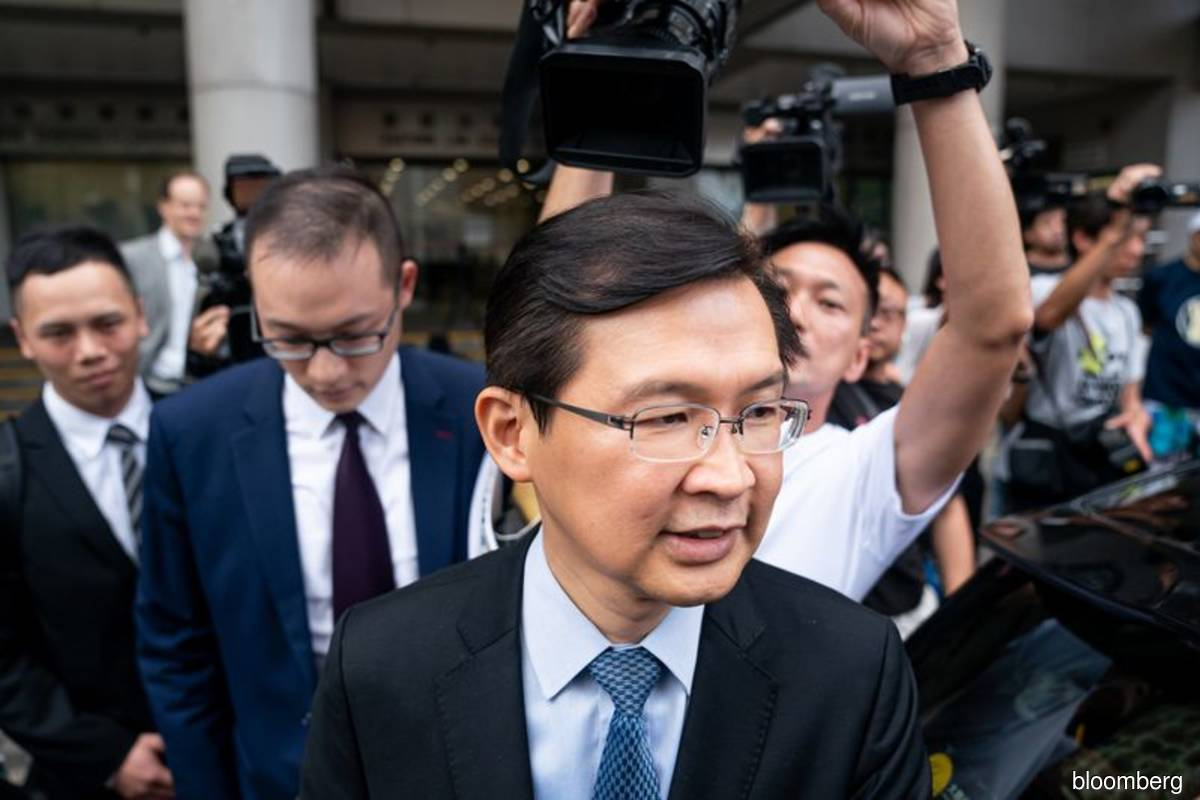 Hong Kong doctor cleared in massive securities fraud probe