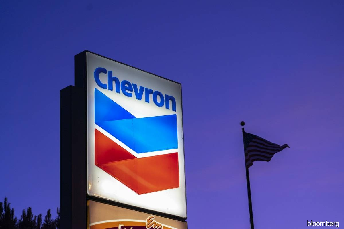 Chevron posts profit on deep cost cuts, improved oil prices