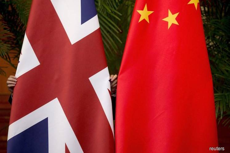 China expresses regret S.China Sea issue has harmed UK ties