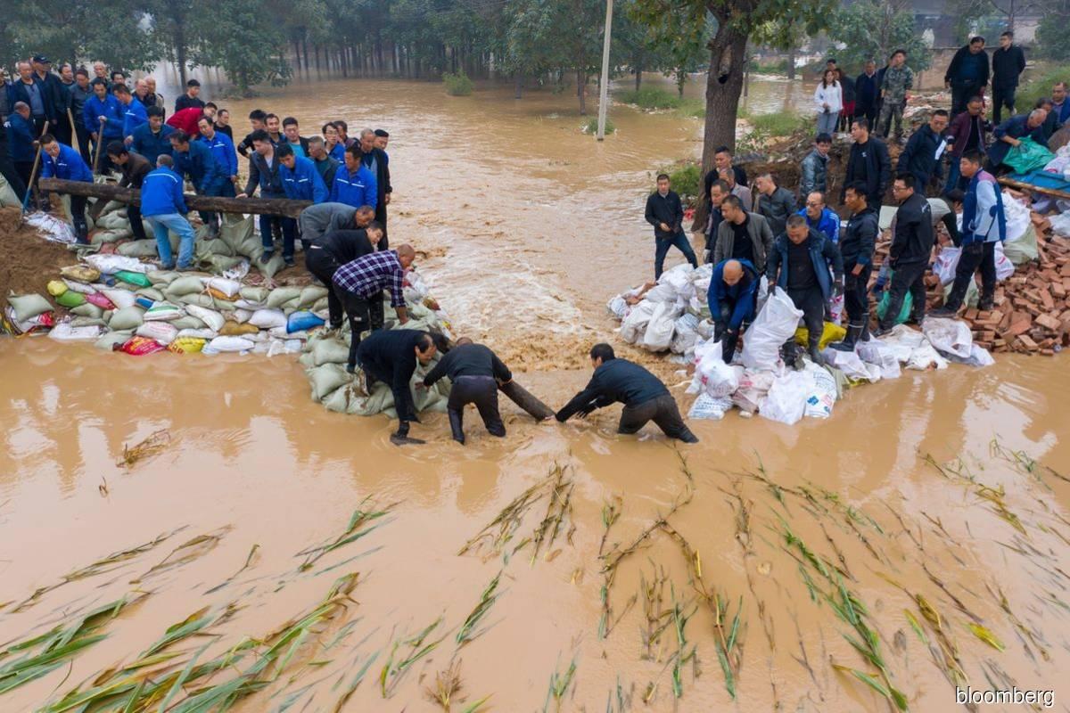 China coal futures surge to record as flood swamps mine hub