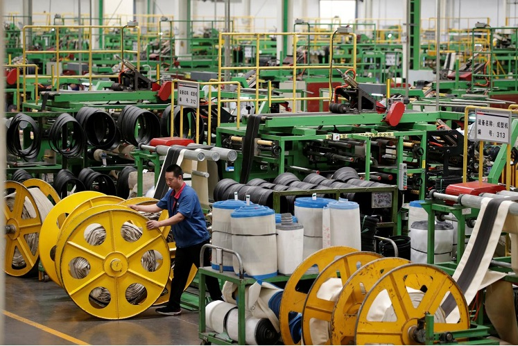 China's May factory activity expands, but weak orders signal bumpy recovery