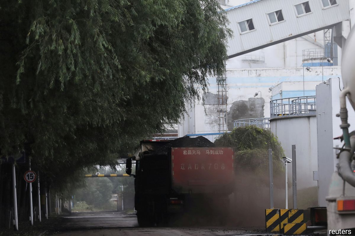 A truck transports coal at a coal-fired power plant in Shenyang, Liaoning province, China September 29, 2021.