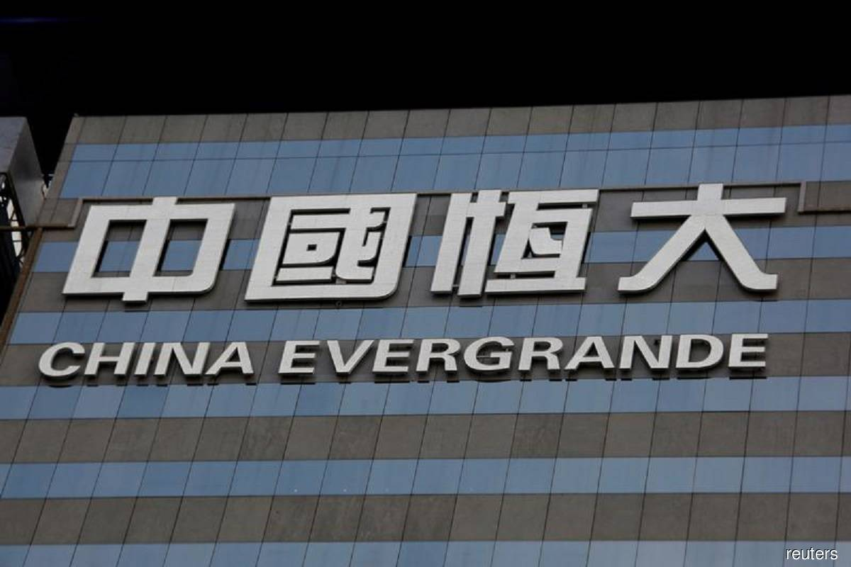 China's indebted Evergrande to sell stakes in internet unit