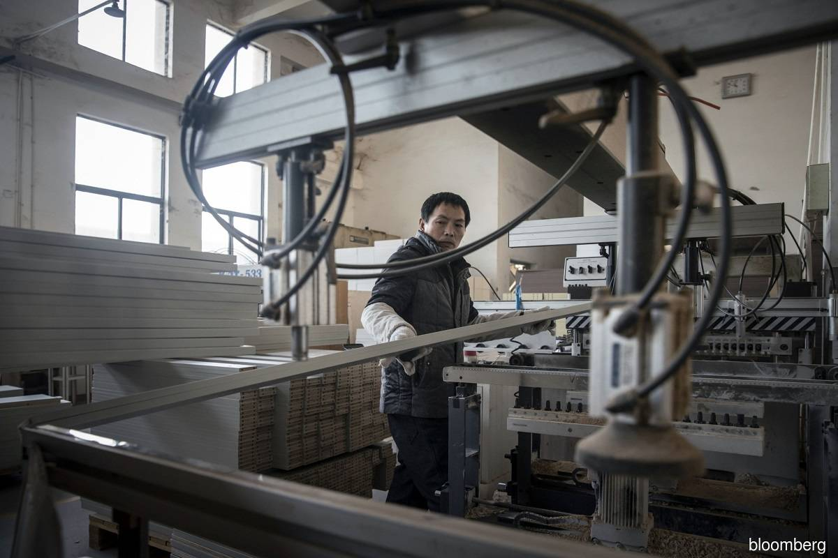 China's factory activity growth slows in January due to COVID-19