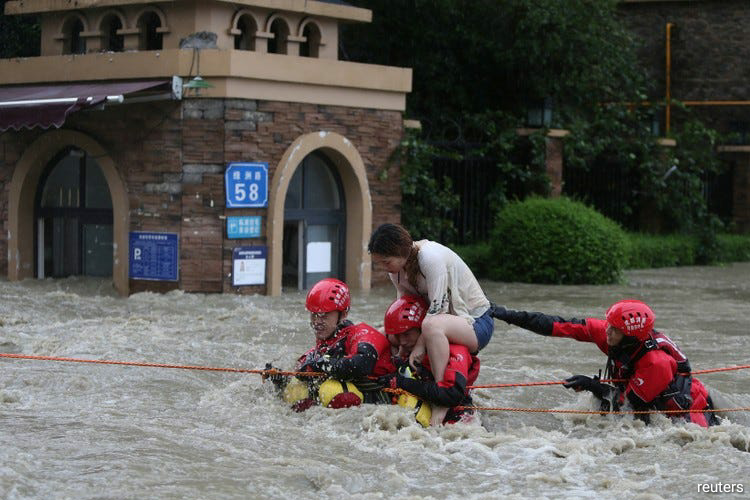 According to the Ministry of Water Resources, 212 rivers have exceeded alerting levels since early July, with 19 of them rising to historical highs. (Photo by Reuters)