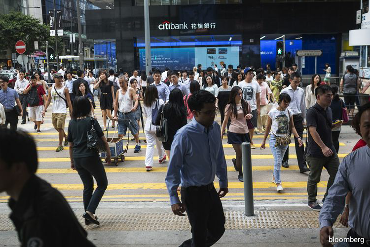 Hong Kong, which has largely contained the local spread of the virus with only 1,055 cases and just four deaths since the crisis began, recently went 23 days straight without any community transmission of Covid-19. (Photo by Bloomberg)