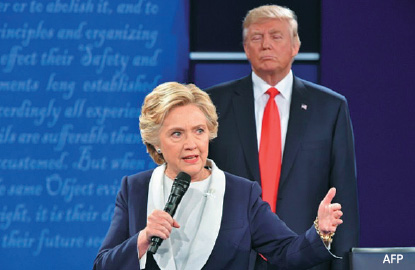 Clinton and Trump chase last-minute support on U.S. election eve
