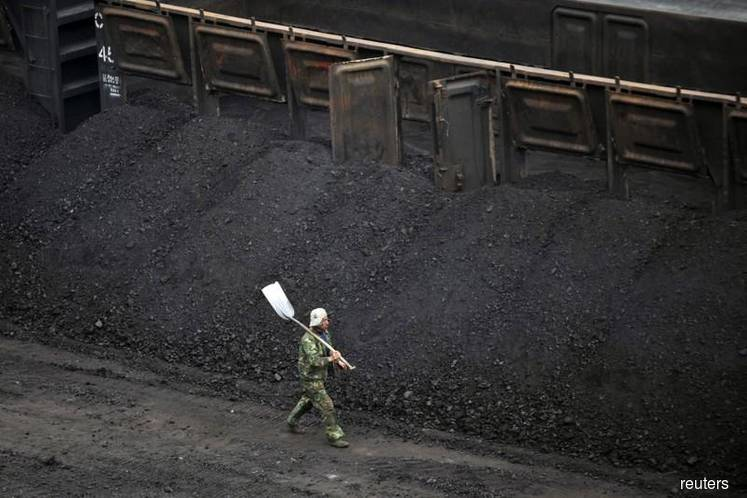 Strange days for coal with Glencore's cap, China curbs: Russell