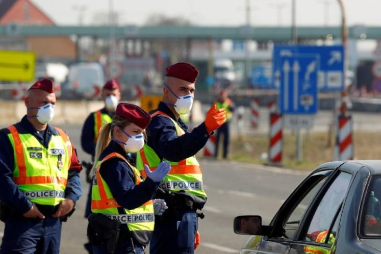Hungary to review rules on travel to neighbours after COVID-19 spikes